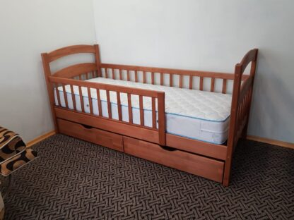 Детская кровать односпальная «Карина Люкс усиленная» с ящиками и бортиками